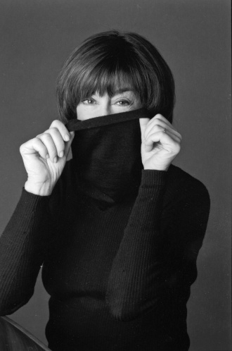 Nora Ephron sweater over face