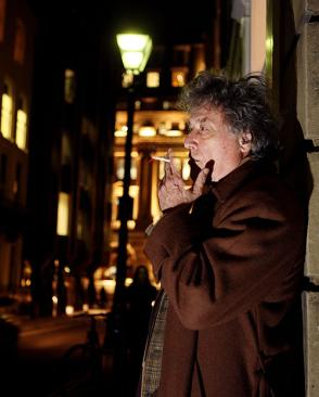 Tom Stoppard at night with cigarette