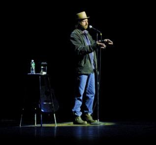 Steven Wright on stage