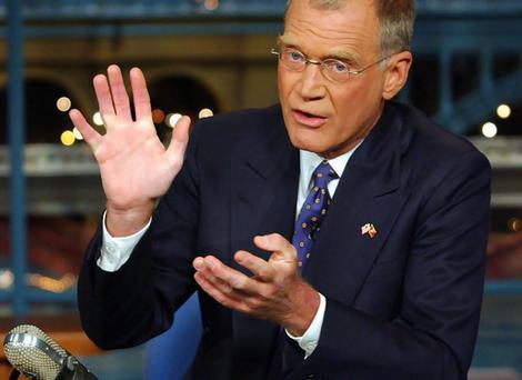 David Letterman at desk