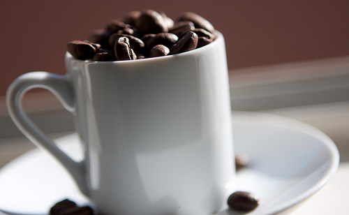 Cup full of coffee beans JcOlivera Flickr stream