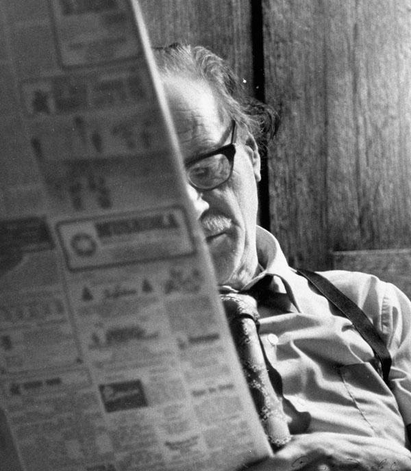Marshall McLuhan reading newspaper