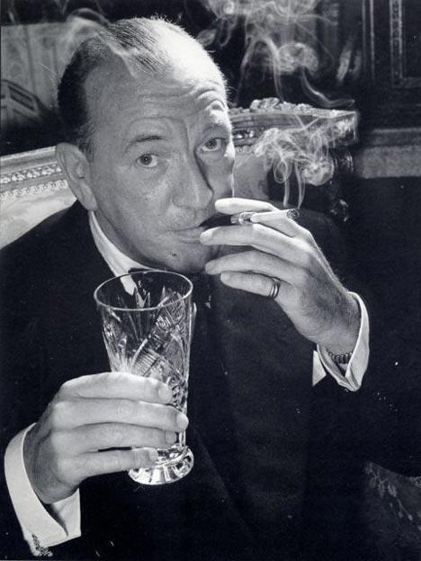 Noel Coward with cigarette holder