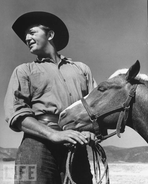 Robert Mitchum with horse LIFE magazine