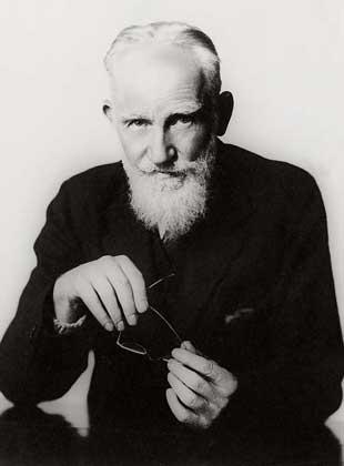 George Bernard Shaw holding glasses