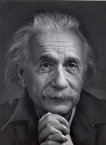 Albert Einstein hands clasped