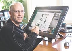 Scott Adams drawing Dilbert