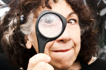 Emily Levine with magnifying glass