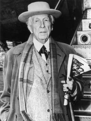 Frank Lloyd Wright with newspaper