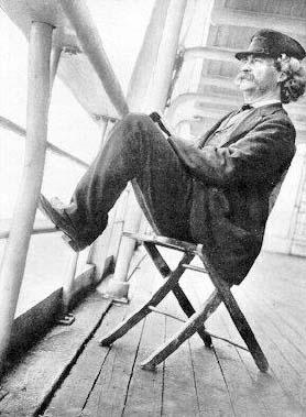 Mark Twain sitting on deck chair