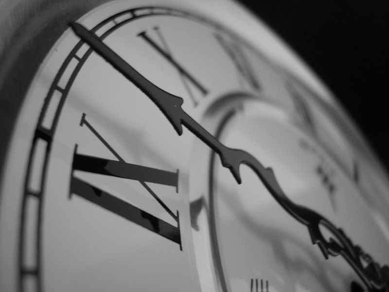 Extreme closeup of minute hand on clock