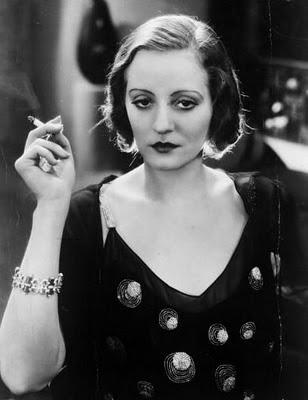 Tallulah Bankhead smoking and glaring