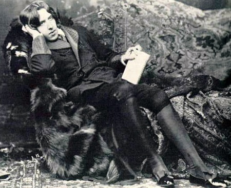 Oscar Wilde reclining on couch