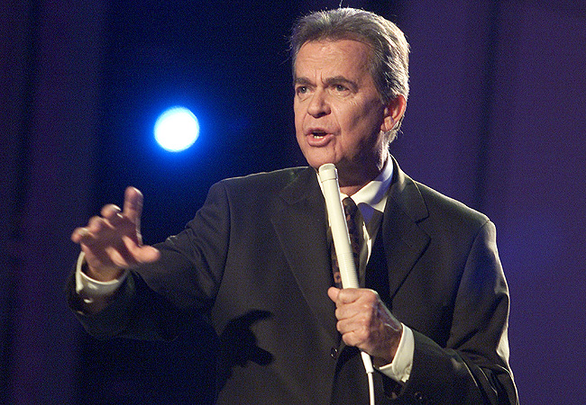 Dick Clark with white microphone American Bandstand