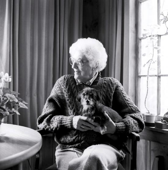 May Sarton holding a dog