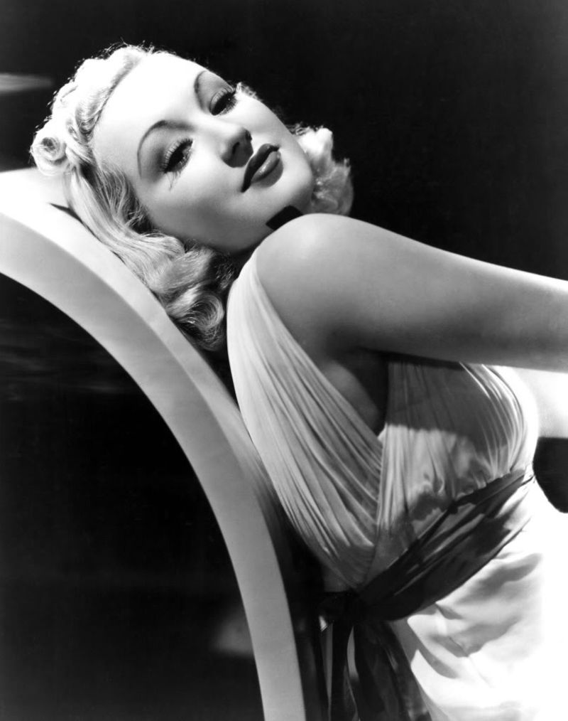 Betty Grable reclining with smile