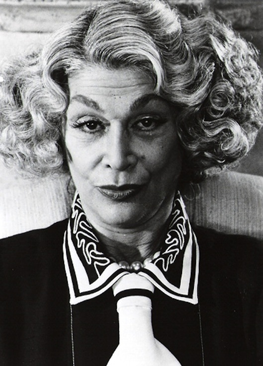 Sylvia Miles on couch black and white