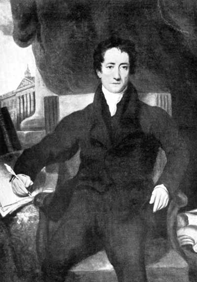Charles Lamb in chair writing