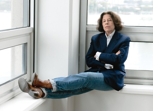 Fran Leibowitz seated at windowsill