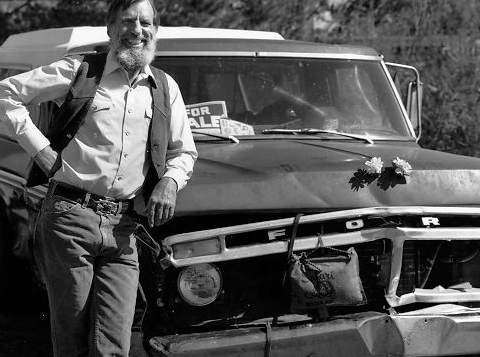 Edward Abbey in front of an old Ford