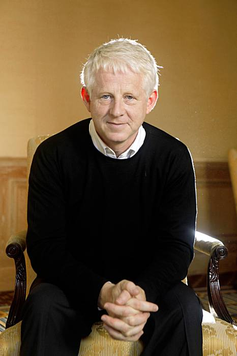 Richard Curtis hands folded sweater