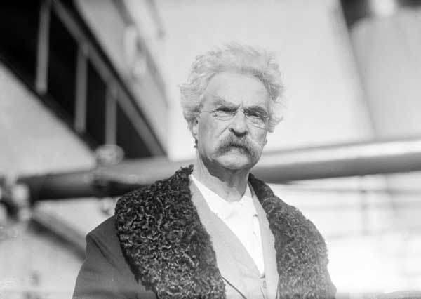Mark Twain on a wharf
