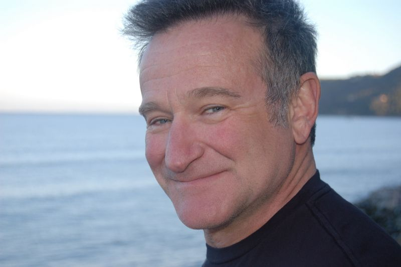 Robin Williams smiling on beach