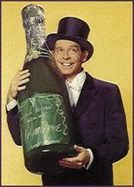 Milton_berle_with_oversized_bottle