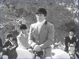 Rita_mae_brown_on_horseback
