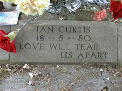 Ian_curtis_gravestone_love_will_tea