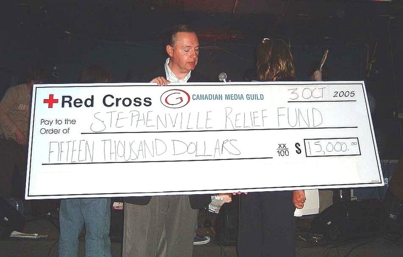 Karl_wells_with_cheque